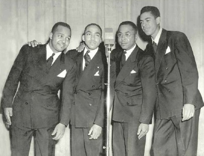 """Murphy church leader and community activist Frank Sudderth led a singing group, the Gospel Echoes circa 1940s. From left: Charles """"Chate"""" Sudderth, William """"Boodle"""" Sudderth, Frank Sudderth, and Bobby Jones. Image courtesy of Mildred Jones. On loan from the Mountain Heritage Center, Western Carolina University."""