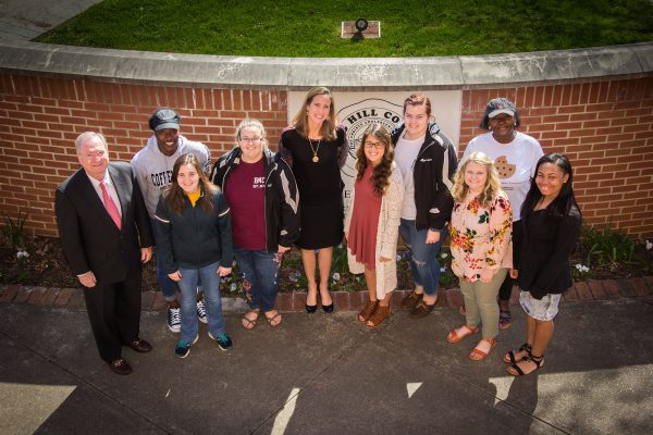 Lyons Gray (far left), vice chair of the board of trustees, and Carrie Conway (center left), senior program director of the Lettie Pate Whitehead Foundation, with MHU students (l-r) Shaniqua Steven, Megan Towles, AnahBelle Hall, Sabrina Hall, Allyson Puckett, Emilee Crowder, Venicka Girtman, and KeAsia Jones.