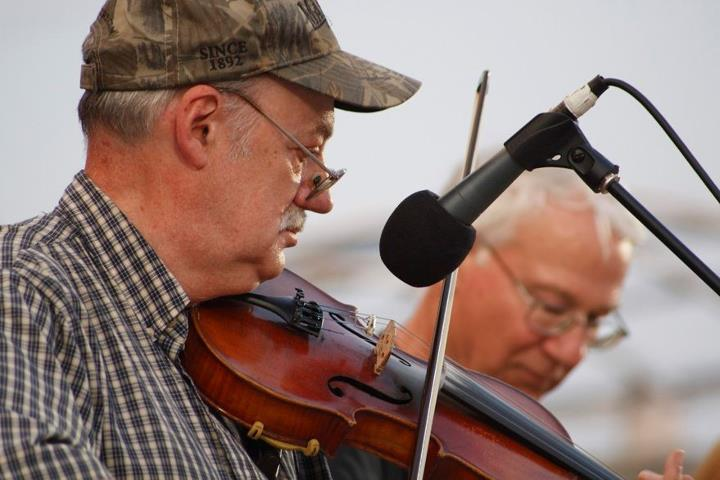 Roger Howell playing the fiddle